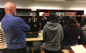 Visitors listening to Librarian Ben Edwards speak at Wernham West Library