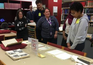 Visitors listening to Archivist, Charlotee Chaffey, speak at Wernham West Library