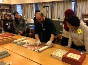 Librarian Max Dionisio showing visitors a Japanese scroll